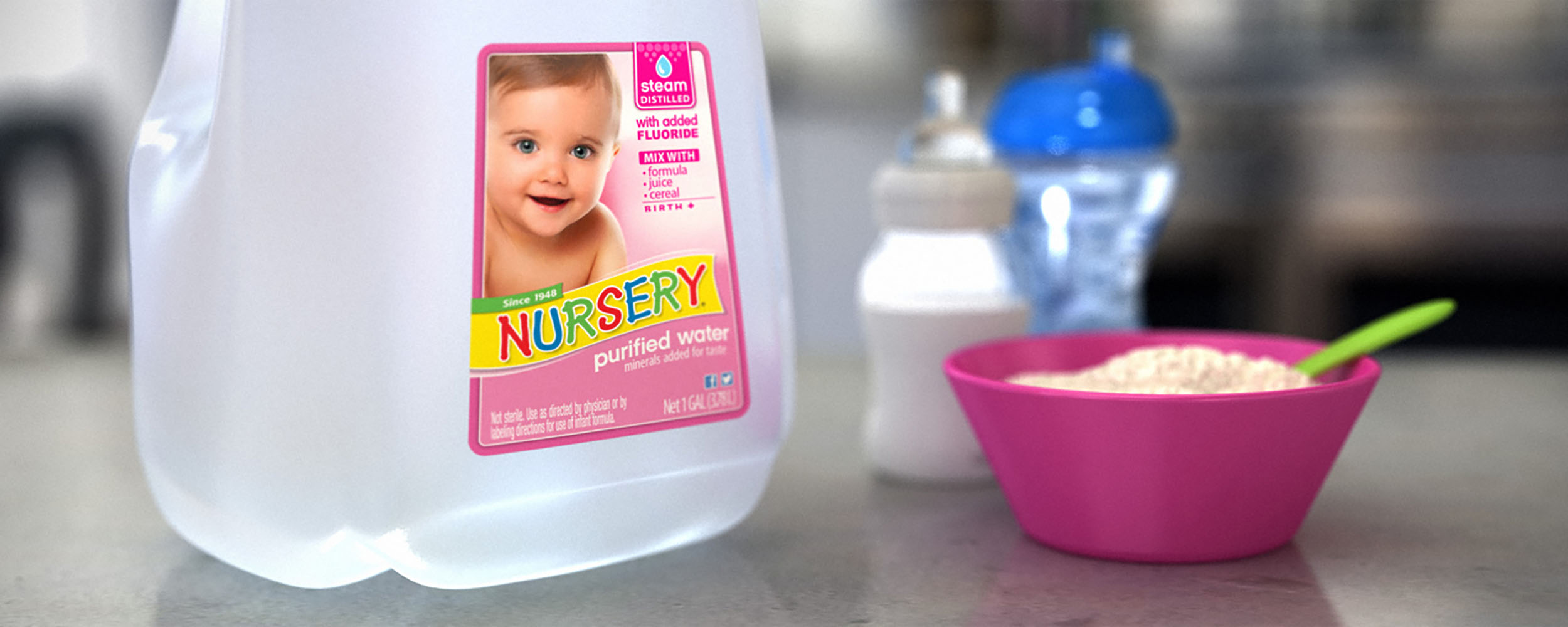 nursery water gallon next to bowl of porridge
